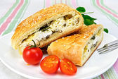 Roll filled with spinach and cheese in bowl on tablecloth — Stock Photo