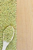 Lentils green on board on the left with spoon — Stock Photo