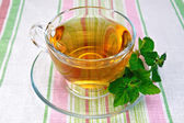 Tea with mint in cup on napkin — Foto Stock
