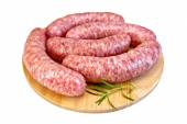 Sausages pork on round board — Stock Photo