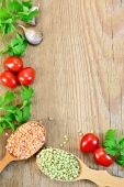 Lentils in spoonful with vegetables on board frame — Stock Photo