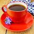 Chicory drink in red cup with napkin and flower on board — Stock Photo #58690395