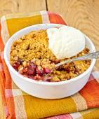 Crumble cherry in bowl with ice cream on board — Photo