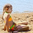 Girl on sand by the river — Stock Photo #60635197