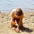 Girl playing with sand — Stock Photo #60635225