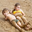 Two girls in the sand — Stock Photo #60635971