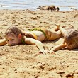 Two girls on sand by the river — Stock Photo #60636017
