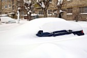 Car buried in snow — Stock Photo