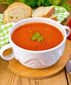 Soup tomato with pepper in bowl on board — Stock Photo