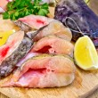 Catfish raw with lemon on board — Stock Photo #61838151