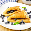 Pancakes with blueberries on wooden board — Stock Photo #64283997
