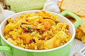 Pilaf with seafood and bread on board — Stock Photo