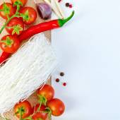 Frame of funchoza and tomatoes with paper on sacking — Stock Photo