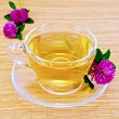 Herbal tea with clover on bamboo napkin — Stock Photo #70712367