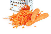 Carrots grated and whole with grater — Stock Photo
