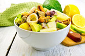 Salad seafood and avocado in bowl on light board — Stock Photo