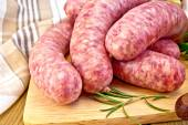 Sausages pork on board with napkin — Stock Photo