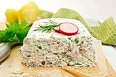 Terrine of curd and radish on paper and board — Stock Photo