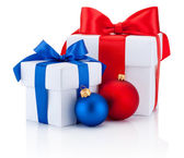 Two white boxs tied red and blue ribbon bow and christmas balls — Stock Photo