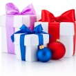 Three white boxes tied red, pink, blue ribbon bow and christmas — Stock Photo #60533567