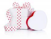 Two White boxs tied satin ribbon bow with heart symbol Isolated  — Stock Photo