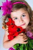 Beautiful girl and tulips — Stock Photo