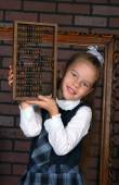 The girl in a school uniform — Stock Photo
