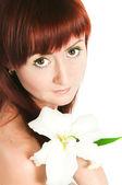 A menina com uma flor de lírio — Foto Stock