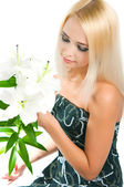 blond girl with a lily  — Stock Photo