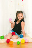Girl with multi-colored balls — Stock Photo