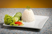 Rice on white plate — Stock Photo