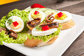 Crostini with anchovy — Stock Photo