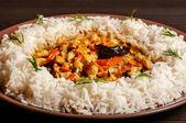 Rice on brown plate — Stockfoto
