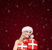 Beautiful girl in Christmas cap holds a set of presents — Stock Photo