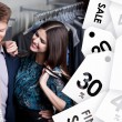 Attractive woman and young man are in the shop on sale — Stock Photo #58634833