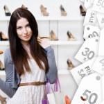 Woman keeping stylish pump on seasonal sale — Stock Photo #58636663
