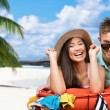 Happy couple packs up suitcase with clothing for traveling — Stock Photo #58637085