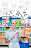 Girl at the market with cosmetics in hands. Seasonal sale — Stock Photo