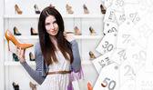 Woman keeping stylish pump on seasonal sale — Stock Photo