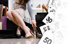Female legs and variety of shoes. Black Friday sale — Stock Photo