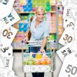 Girl with cart full of food in the shopping center. Sale coupons background — Stock Photo #59094317