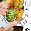 Girl at the store choosing fruits hands watermelon on sale — Stock Photo #59094691