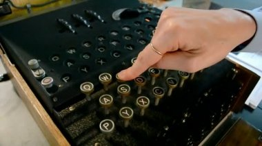 Encrypting technology, Enigma machine under processing, security details. — Stockvideo