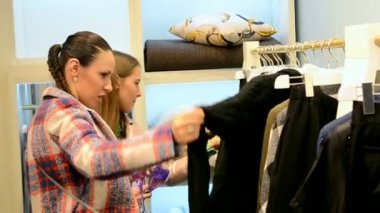 Female in shopping center select new clothing, Mercedes Benz Kiev Fashion Days. — Stock Video