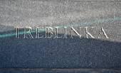 Treblinka concentration camp, text closeup on stone wall. — Stock Photo