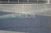 Sobibor, message closeup on stone wall. — Stock Photo