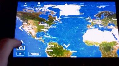 Delta Air Lines (aka Delta) airplane travel monitor closeup, travel tehnology diversity. — Stock Video