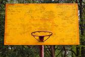 Yellow basketball backboard with ring — Stock Photo