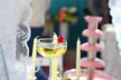 Glasses with champagne on festive table — Stock Photo