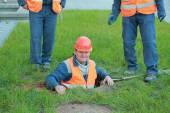 Sewerage workers near manhole — Stock Photo
